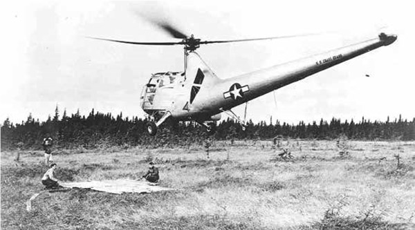 A HOS-1 lands with a survivor from the crash site of a Sabena Airways DC–4 during the hallmark life-saving mission, September 1946. USCG photo