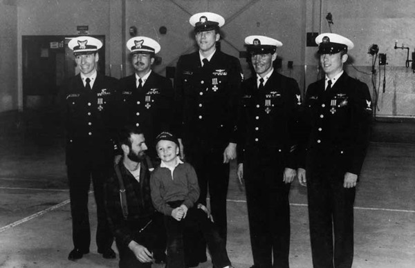 Jim and Clint blades (kneeling) with the crew of HH–3F 1486 (recently restored at the National Naval Aviation Museum) that rescued them from Sitka Sound in December 1987. Allen Skora via Martha LaGuardia-Kotite