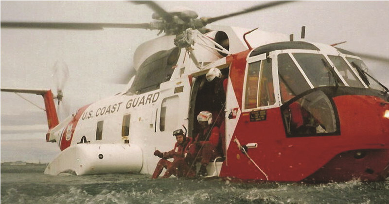 An early Coast Guard rescue swimmer rests aboard an HH–3F Pelican. Prior to development of the rescue swimmer program, Pelican (and the related HH–52 Seaguard) crews often had to utilize the helo's unique amphibious capabilities during rescues. USCG photo