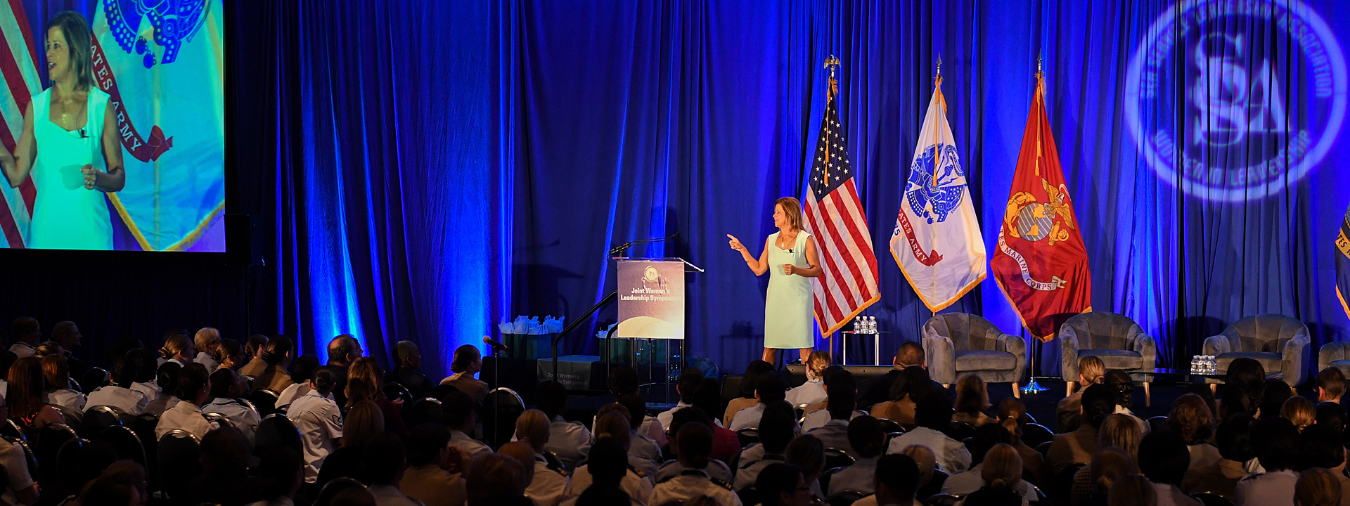 Martha LaGuardia-Kotite on stage at the 2019 Joint Women's Leadership Symposium.